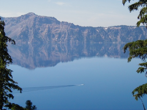 A Boat Crossing Crater Lake