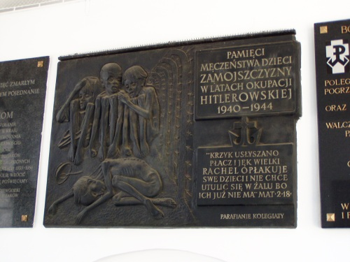 "The Plaque roughly reads, ""Remember the Suffering of the Children of Zamosc during Hitler's Forced Occupation"""