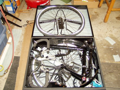 The disassembled bike in its case